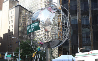 Climate-change protesters arrested climbing globe outside Trump Hotel