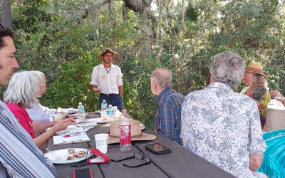Nick talks with people at Manatee Park about the climate crisis